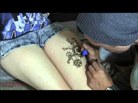 simple arabic mehndi tattoo design on legs by henna city
