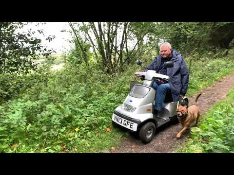 Carry on dog walking with a mobility scooter - Malcolm & his TGA Breeze S4 YouTube video thumbnail
