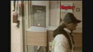 Funny cctv footage - Robber has door problems as he fails at robbing bank