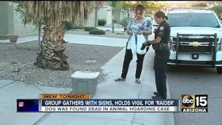 Group holds vigil for dog killed while in rescue's care