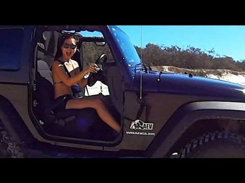 Jeep Wrangler JK on the beach, 4x4 and camping