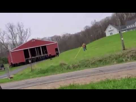 "300 Amish men work together to ""walk"" a pole barn to a new location"