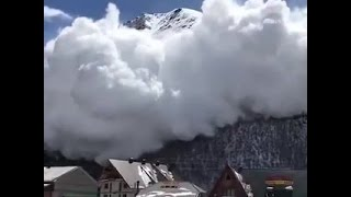 Watch as an avalanche quickly approaches a ski resort