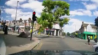 video: Watch: Falling tree narrowly misses pedestrians at London crossroads