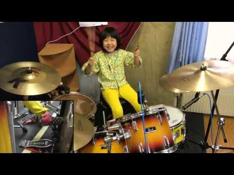 8 year old girl on the drums absolutely crushes it on Led Zepplin's Good Times Bad Times