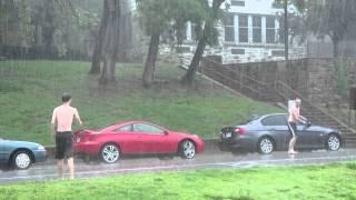 KK men playing brisbees in the rain 05/06/2012
