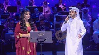 الفنانة أصيل هميم والفنان ناصر الكبيسي في أغنية أمضي بلادي بمشاركة العازفة هالة العمادي تحميل MP3