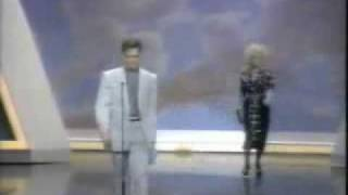 Dolly Parton sneaks up on Randy Travis