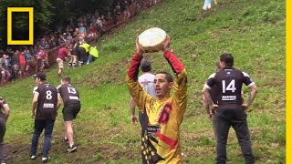 Watch a Downhill Cheese-Chasing Competition in Britain | National Geographic thumbnail