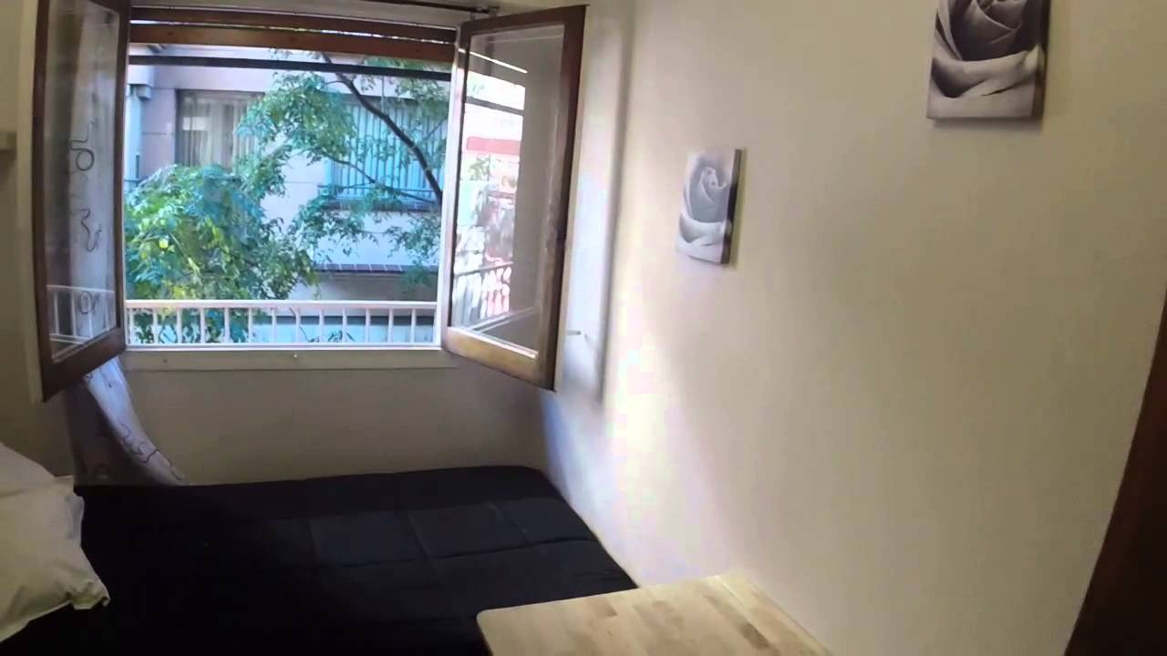 Sunny room with window with street view in shared apartment, Sagrada Familia