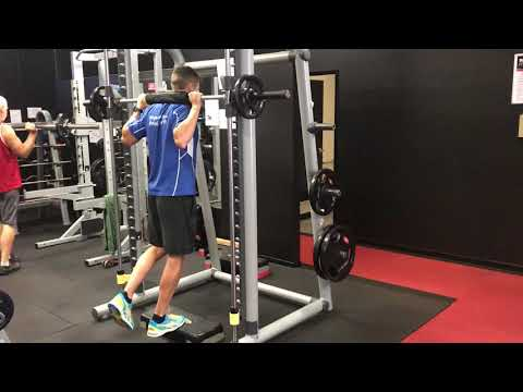 Single leg calf raises (smith rack) from step