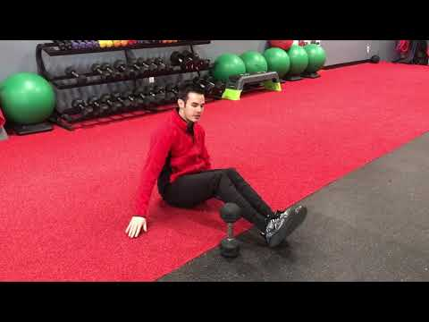 Seated Leg Raise Over Dumbbell