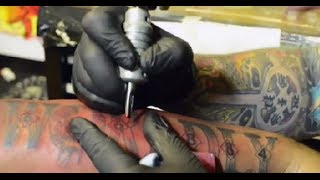 Tech N9ne Gets Worldly Angel Tattoo