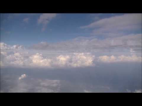 the-airplane-soars-and-through-it-in-the-clouds-in-the-plane-going-to-bangkok-from-narita