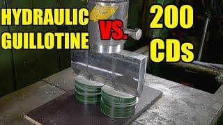Splitting 200 CDs with Hydraulic Press | in 4K!