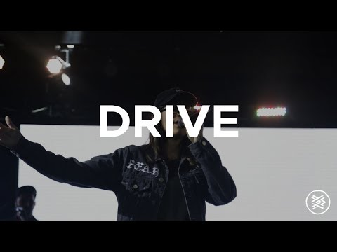 """Singing an original song """"Drive"""" recently w/ band."""