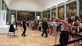 Visiting Mona Lisa at the Louvre on a busy summer day