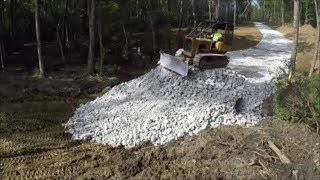 Installing A Culvert Pipe For The Driveway And Covering With Surge