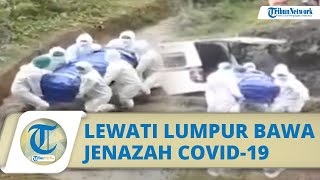 Viral Video Petugas Lewati Sawah Berlumpur Bawa Jenazah Covid-19 untuk Dimakamkan
