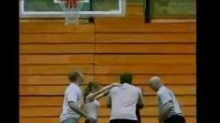 Girl jumping in basket of basketball