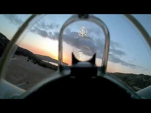 fpv-air-combat-in-rc-spitfire-at-sunset