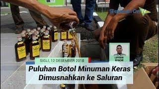 Puluhan Botol Minuman Keras Dimusnahkan ke Saluran