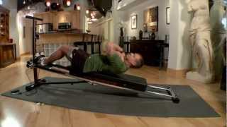 Sit ups on the Total Trainer Home Gym