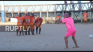 Brazil: Pretty in Pink! This referee is more fun to watch than the game he is officiating