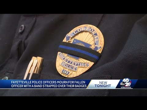Fayetteville police honor slain officer with mourning band