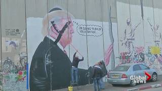 Palestinians paint over mural depicting Donald Trump