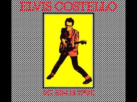 , title : 'Elvis Costello   Less Than Zero with Lyrics in Description'