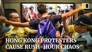 Protesters block subway trains, causing massive delays during Hong Kong rush hour