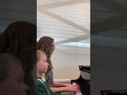 Learning a duet on the piano