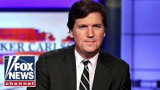 Antifa protesters chant outside Tucker Carlson's home