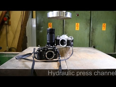 Crushing Old Cameras With A Hydraulic Press Is Tragically Fascinating