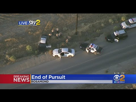 Suspected drunk driver steals a truck, leads a high speed chase through the desert, crashes, ditches his girlfriend while running on foot, steals a cop car, then crashes again