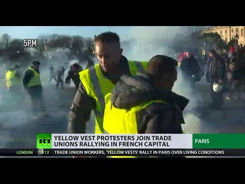 French protesters clash with police in rally over minimum wage & 'anti-hooligan' law