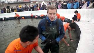 S Koreans drawn to annual ice fishing frenzy