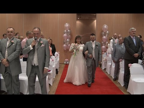 Groom Sings Elvis Number as Bride Walks up Aisle!
