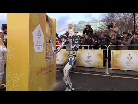 Robots run as PyeongChang Winter Olympics torchbearers