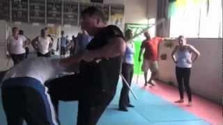 KC James teaching stick defense in Liberia - Video Youtube