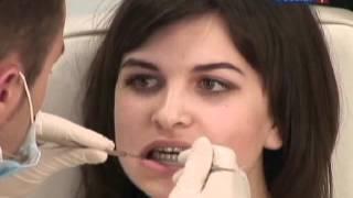 Что делать если десна поднялась над зубом