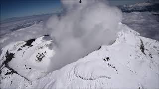 Crater Cotopaxi active volcano in Ecuador, fly by Sinus Pipistrel