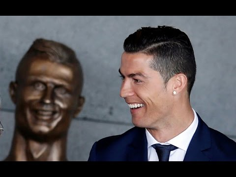 Heads turn as Ronaldo airport overshadowed by golden bust