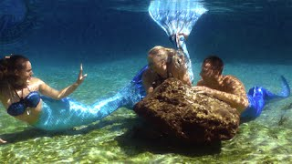 mermaids & merman swim together underwater