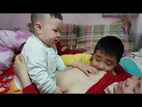 Afternoon breast feeding with 2 child FUNNY BABY BEATIFUL MOM