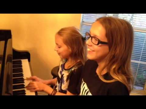 Here are two really cute girls (sisters I might add) getting it all together to play a duet for their teacher.