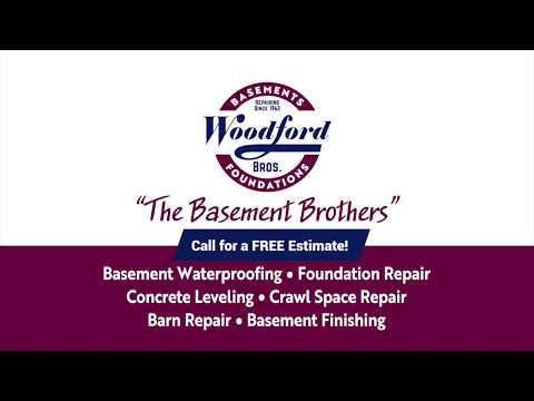 Woodford Bros., Inc. crew on location permanently stabilizing the walls of a home. This homeowner will have total peace of mind. 25-year warranty. Guaranteed.