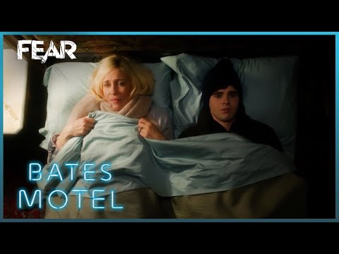 Mom and son share hotel bed