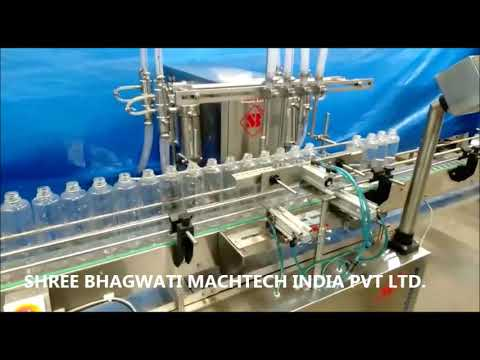 Four Head Volumetric Liquid Bottle Filling Machine